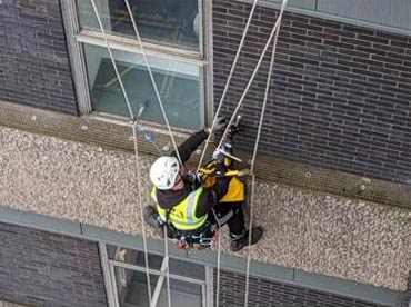 Someone working in a high setting with harness